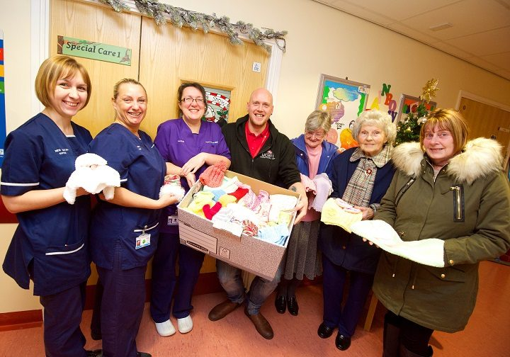 Neonatal Sister Becky Esslemont, Neonatal Senior Sister Mel Gwilt, Neonatal Matron Jo Smith, UCLan's Engagement and Outreach Officer Lee Macneall, and knitters Enid Bosworth, Olive Appleby and Pat Morris.