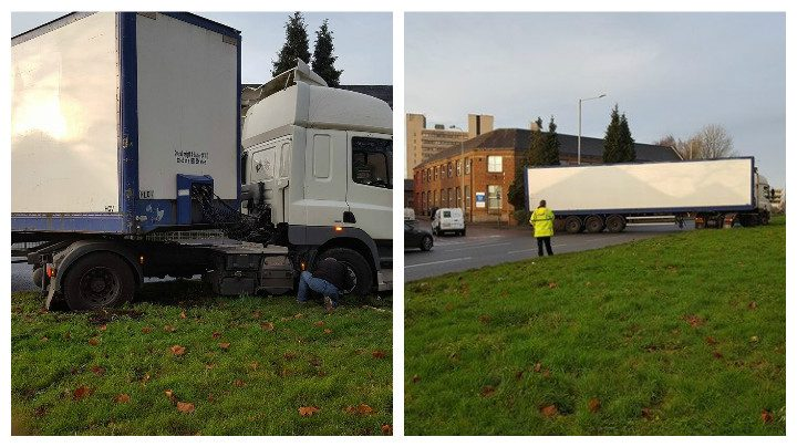 The driver can be seen trying to rescue his lorry as a policeman watches on Pic: Andy Spearitt
