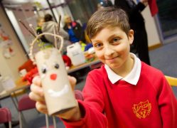 One of the pupils taking part in making Christmas decorations in the UCLan shop