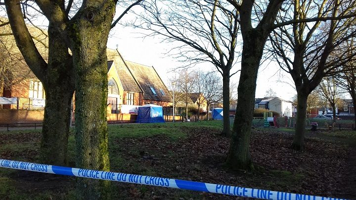 Forensics tents can be seen close to the community centre