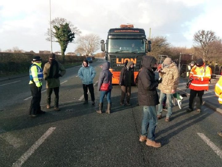 Police speak to protesters blocking a lorry at Preston New Road Pic: Business Lancashire