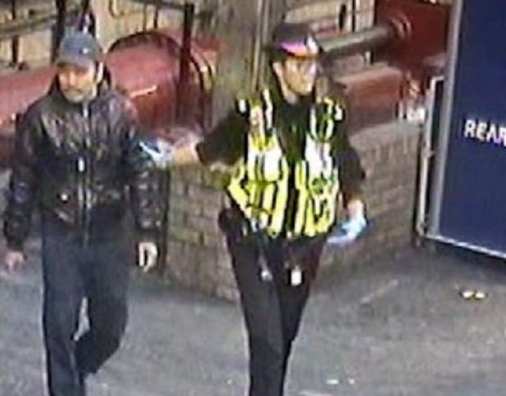Hoang Ho being led away at Glasgow Central station