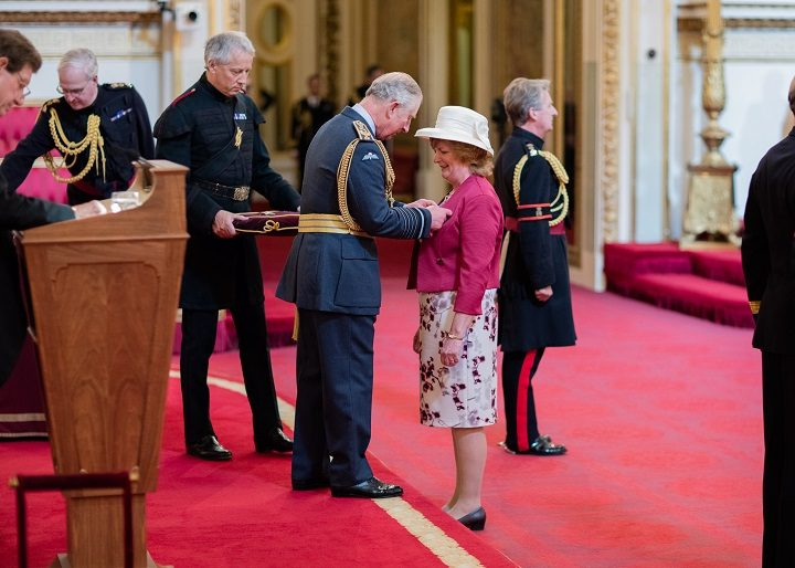 The moment Dame Watkins received her award