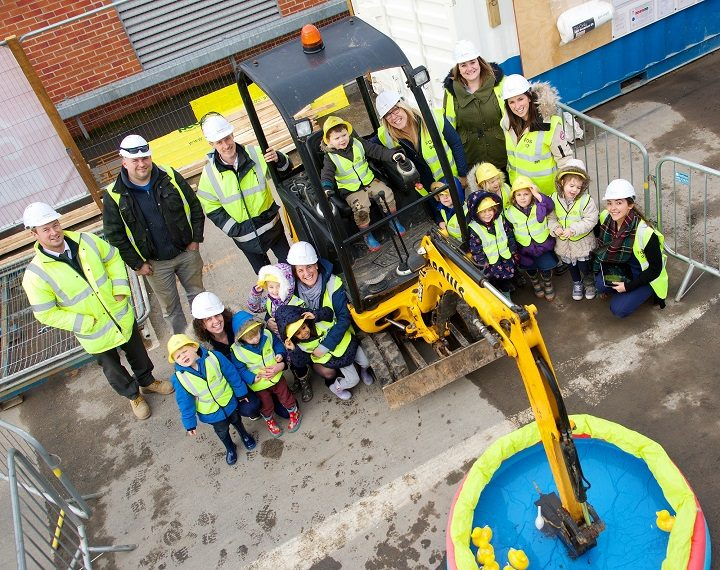 The pupils got very hands on during the visit, steady with that digger young man!