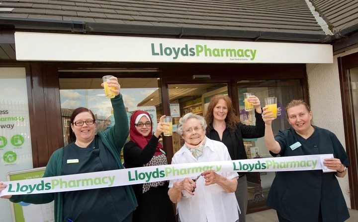 Doreen Wickes from Clayton opens the pharmacy watched by Wendy Scanlon, pharmacist Meriem Denai, practice manager Kelly Howarth-Lloyd and Margaret Hampson.