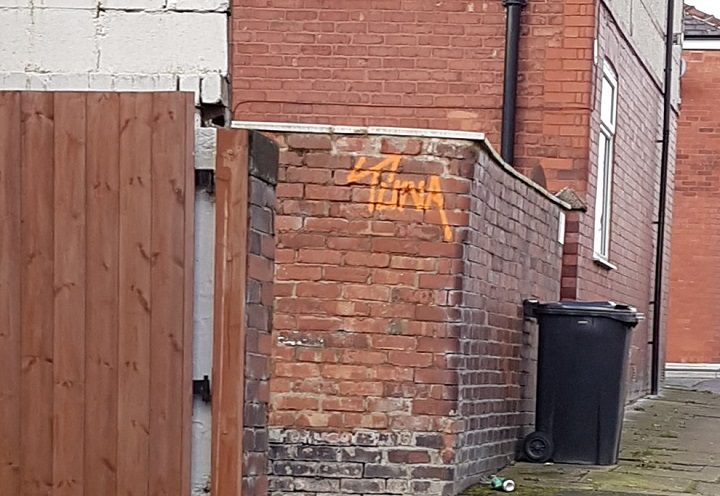 The tag on the wall of a property in Ashton
