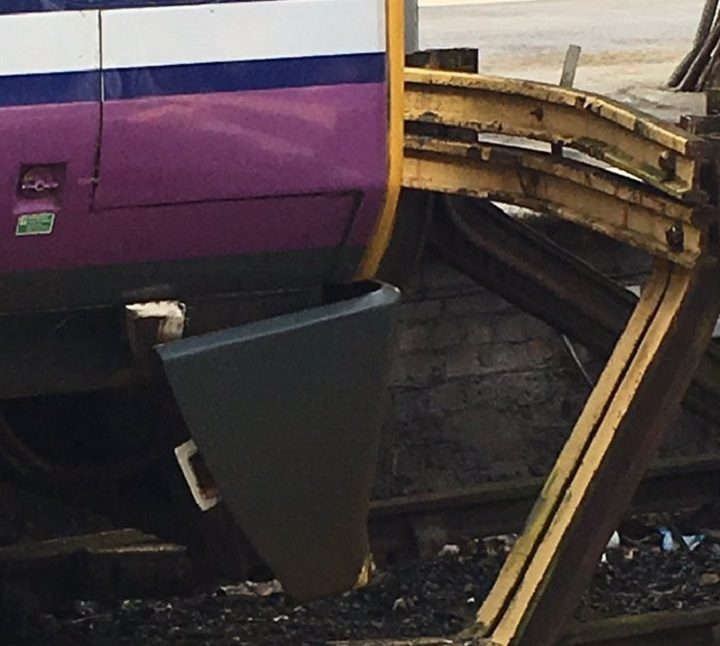 Close-up showing the bumper of the train coming off
