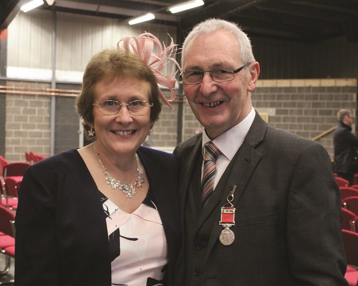 Ron with his wife Christine after receiving his medal