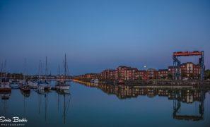 Full moon rising over the Docks
