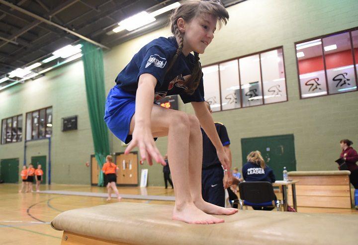Katie Mann from Queen's Drive school doing her gymnastics