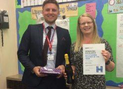 Michelle Iddon receiving her award