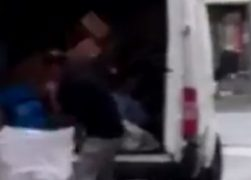 The driver can be seen throwing the parcels into the van from the sack