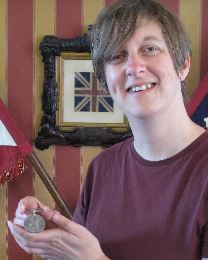Private Cooper's medal with museum curator Jane Davies