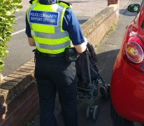 The PCSO on patrol in Penwortham, with a pram