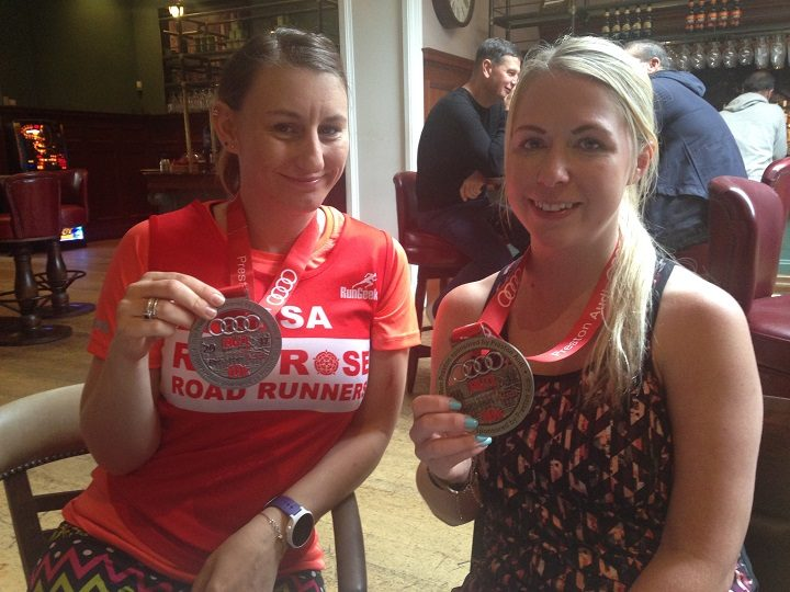 Lisa Baron and Claire Brown with their medals treating themselves to breakfast in Twelve Tellers after the race