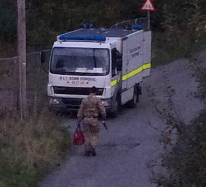 A soldier is seen carrying a red bag from the scene Pic: Lee Stott