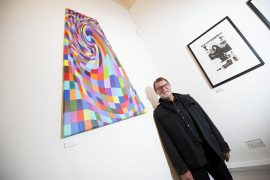 Graham Hill with his artwork on display