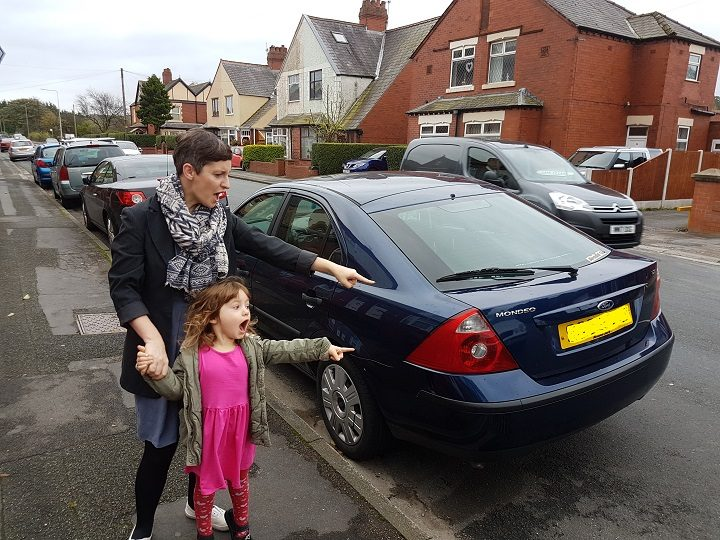 Jennifer and Robyn watch speeding cars in Higher Walton Road