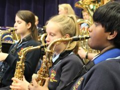 Some of the junior school band performing