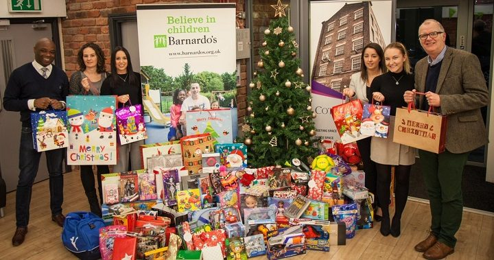 The Cotton Court team with last year's haul of Christmas presents for disadvantaged children in Preston