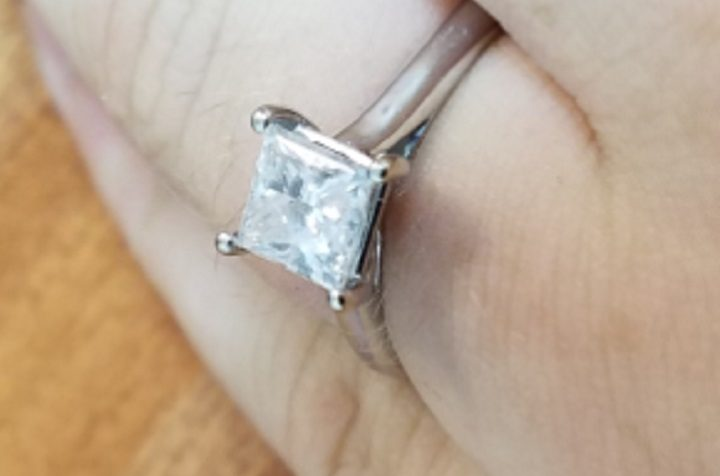 The engagement ring taken from the woman's finger