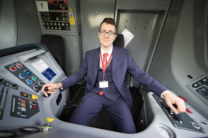Simon in the cab of a Virgin Train
