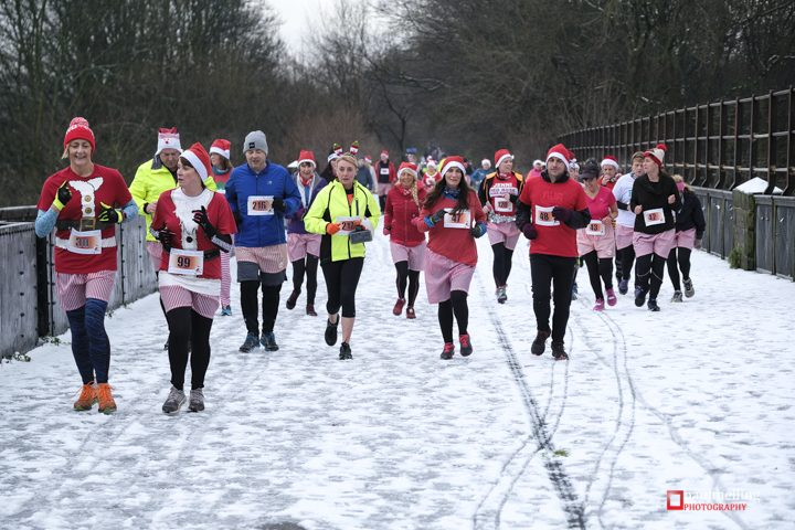 Runners out in Avenham Park during Saturday's Cheeky Santa Dash braved the cold conditions