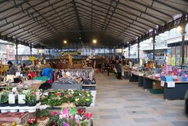The market traders back under the cover of the canopy