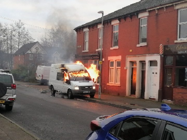 The flames coming from the van in Roebuck Street Pic: Danny Gallagher