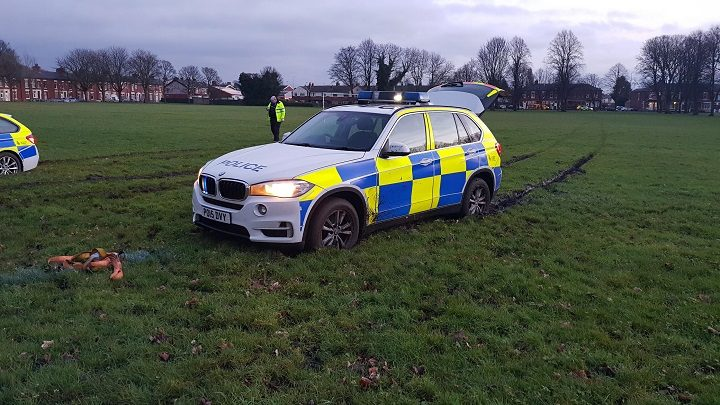 The police vehicles also became stuck in the mud on the park and had to be towed off