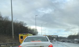 Ambulance on the scene and debris across the M6 at Preston