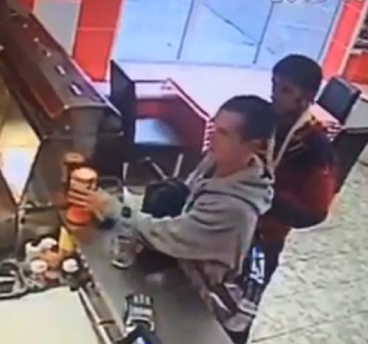 The CCTV clip shows two men in the fish and chip shop