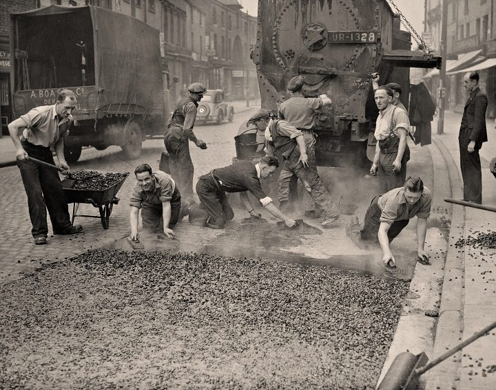 Workers lay tarmac in Church Street in 1938