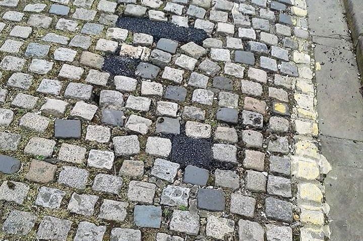 Some of the tarmac which has been put in between the cobbles in Wellington Street