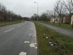 The paper and other items was left strewn across the road Pic: Michael Casterton