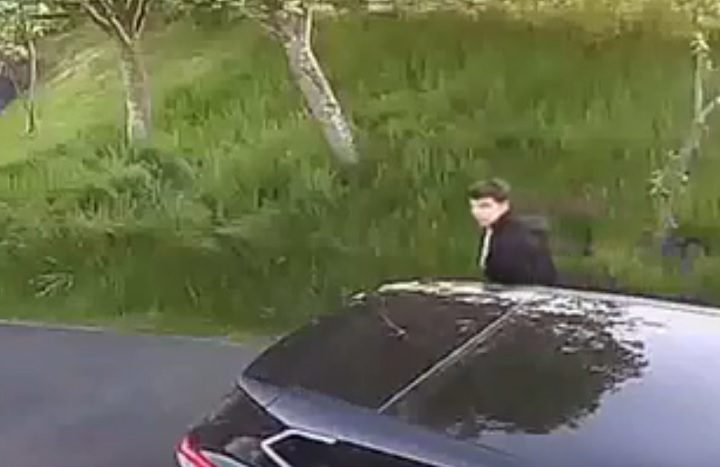 The CCTV shows a man in the area of the car