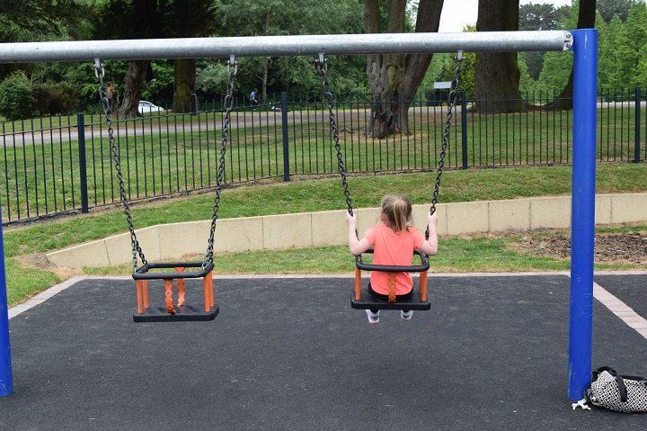 Enjoying the swings in Grange Park