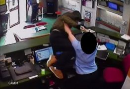 The man is tackled by a staff member