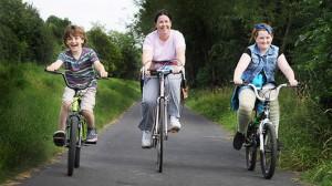 a family enjoy cycling the guild wheel