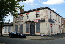 The boarded up pub on the corner of East Street and Holstein Street