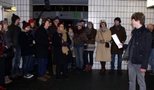 The audience watch on during the performance inside the Bus Station
