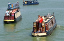 Canal barges make their way into Preston to take their positions for the Riversway Festival