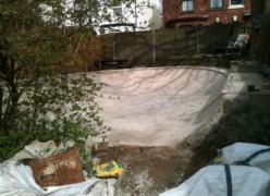 The semi-circular skate ramp in the back garden