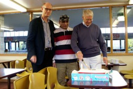 John Wilson, right, who has led the campaign to have the building listed cuts the birthday cake