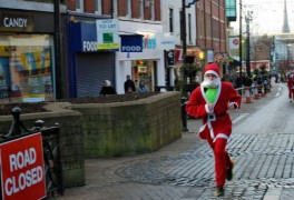 A Santa takes on last year's Dash through the city centre