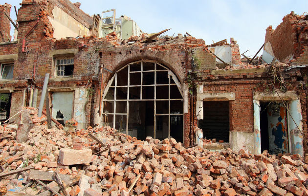 Rubble as one of the former hospital buildings is demolished