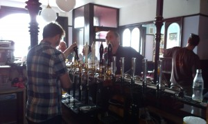 New manager pours a pint for a regular at the Moorbrook