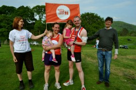 Ben celebrates with his wife Louise and family after finishing