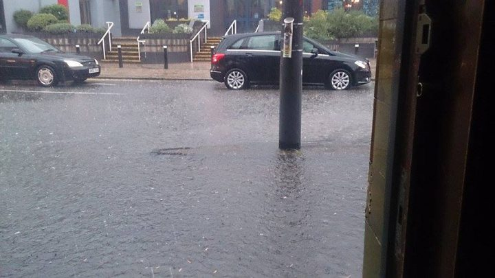 Reader Paul McNeil cleverly sheltered in the pub while the rain came down on Friargate
