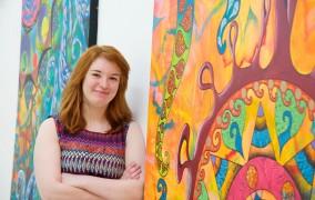Aimee Richard-Davies with her artwork